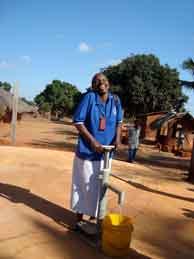 Woman pumping water in Tanzania