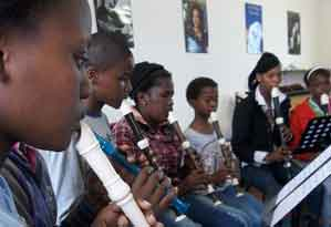 Students learning to play recorder in South Africa