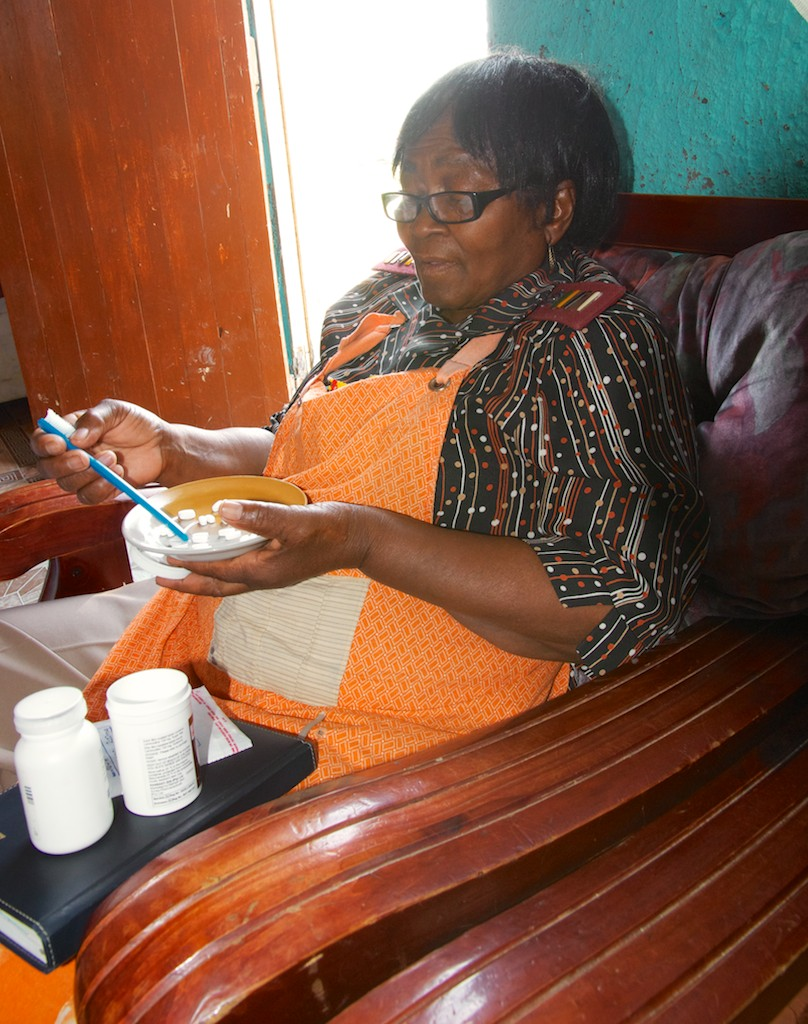 Mrs Zita counting out ARVs