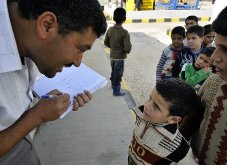 Newly arrived children get registered for school in the Zaatari Refugee Camp, located near Mafraq, Jordan. Opened in July, 2012, the camp holds upwards of 20,000 refugees from the civil war inside Syria. International Orthodox Christian Charities and other members of the ACT Alliance are active in the camp providing essential items and services. Photo: Paul Jeffrey/ACT