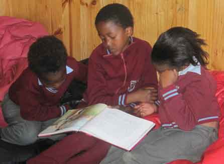 Students reading together at the John Wesley Community Centre in South Africa. Photo: Jeannethe Lara