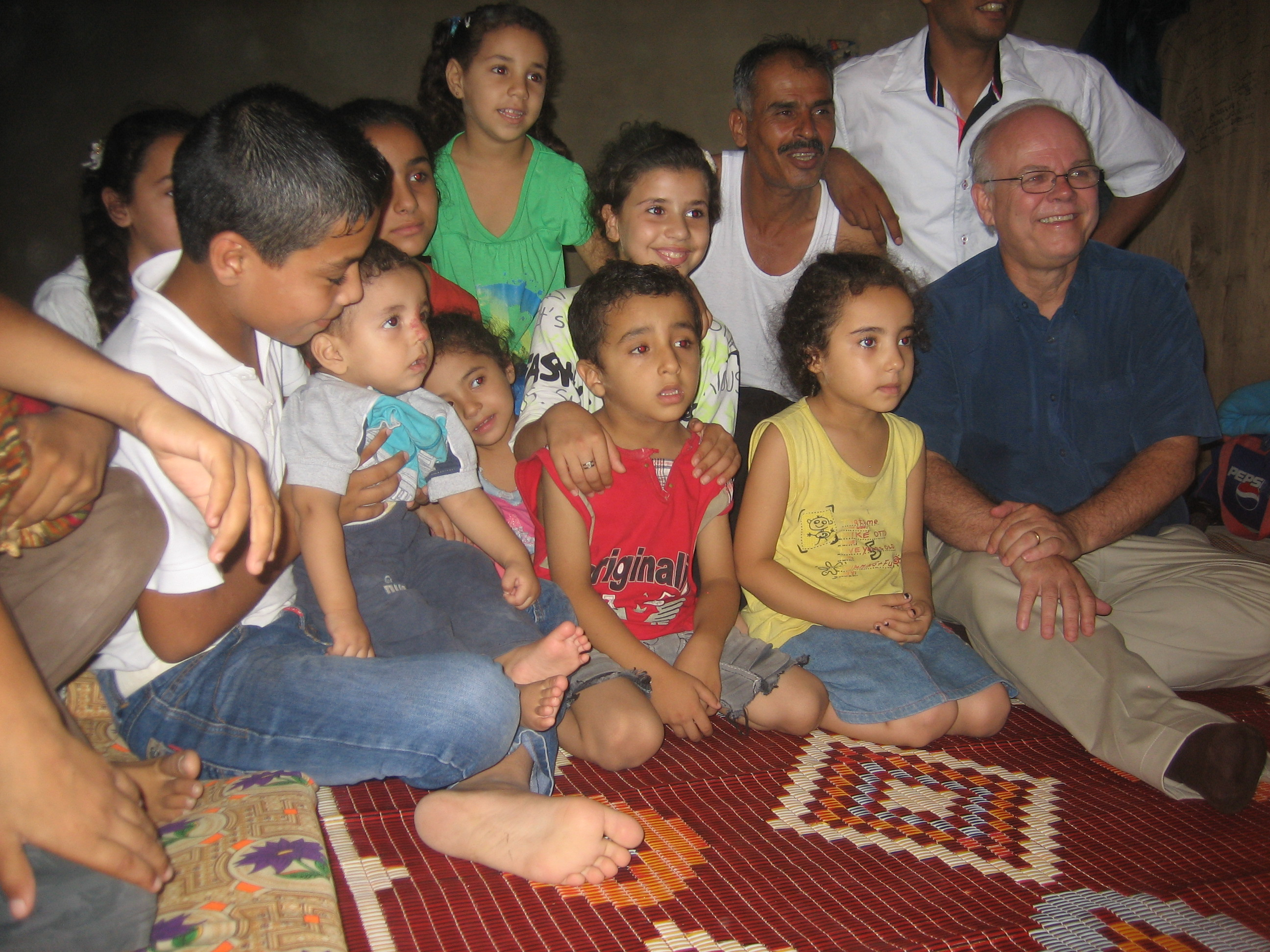 Jim Cornelius with Syrian refugee children in Shabrieh Lebanon. Photo: Joan Barkman, CFGB