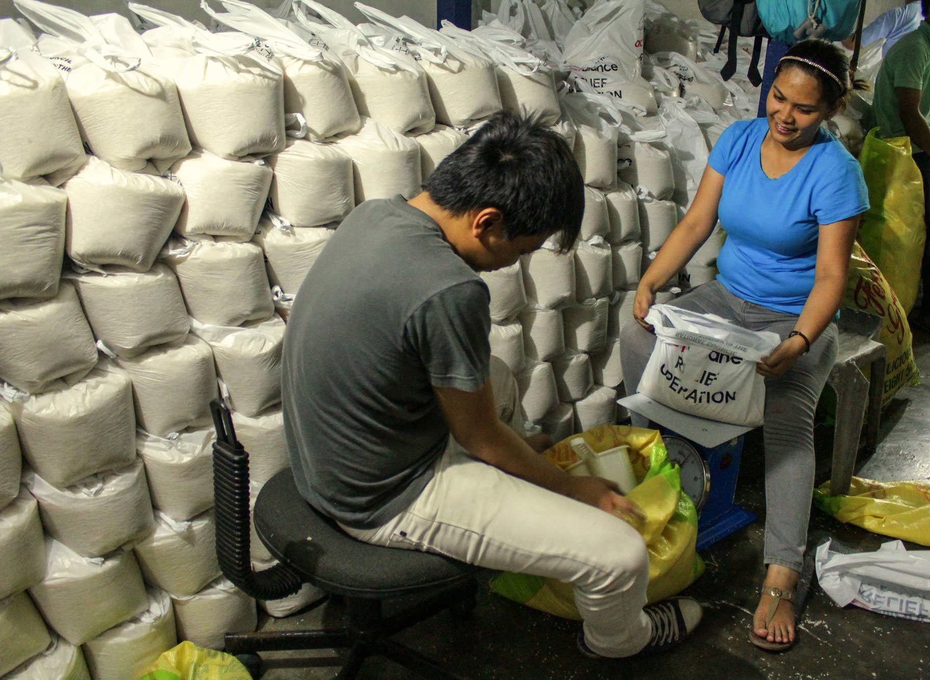 Volunteers with the NCCP prepare food packages for families in the wake of Typhoon Haiyan. Photo: NCCP