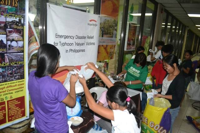 Volunteers in the Philippines prepare relief packages of food for affected families. Photo: SPFTC