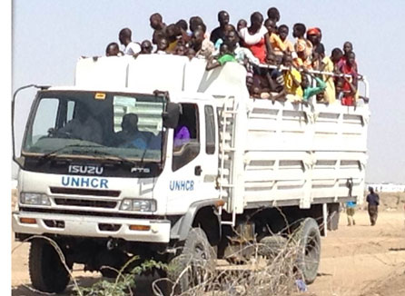 Refugees arriving by UNHCR truck at the Kakuma Refugee Camp in Kenya. Photo: NCCK