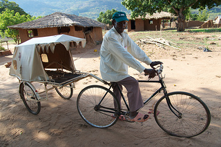 Fransisco dos Santos demonstrates how a bicycle ambulance works in Mozambique. Photo: Simon Chambers