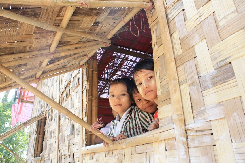 Students in Myanmar look out the window of their school. Photo: ACT/DKH/CWS