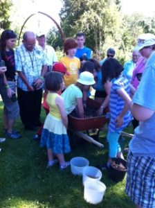 Intergenerational planting of beans for the Sharing Bread Learning Exchange at the Sorrento Centre