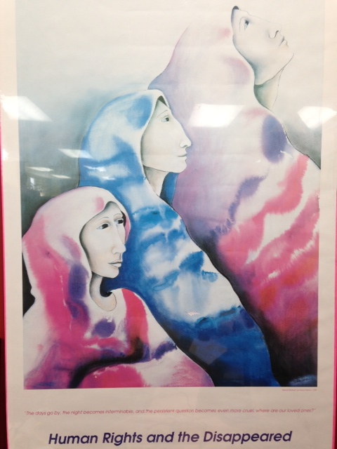 "A poster showing three women looking ahead and upwards and the caption reads: ""The days go by, the night becomes interminable, and the persistent question becomes even more cruel, where are our loved ones?"" Photo: Suzanne Rumsey"