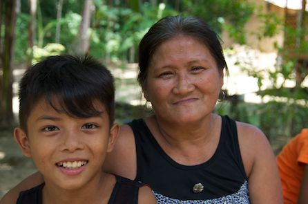 Cira Divino (right) and her 11-year old grandson are thankful that PWRDF has not forgotten the people of Bohol, but are still here helping to rebuild houses destroyed in the earthquake. Photo: Simon Chambers