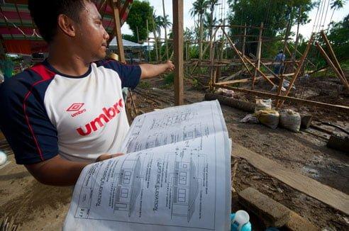Lenon Jake Bay Bay describes the construction of houses in Sabang Bao, Philippines after Typhoon Haiyan. Photo: Simon Chambers