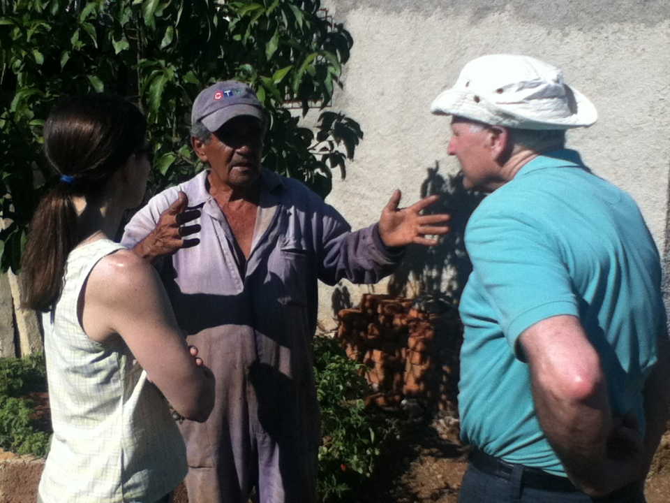 Enrique, the farmer on the Itabo property talking to Don Dewar (Canadian farmer) about the different types of farming methods used in Cuba, with Suzanne Rumsey interpreting. Photo: Sheilagh McGlynn