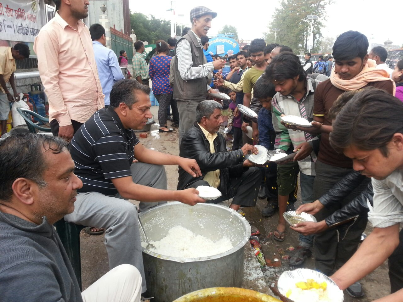 Local communities and civil society have been responding to the earthquake in Kathmandu. Volunteers from Marwari Sewa Samiti distribute cooked meals to people living in the biggest camp in Tudikhel Kathmandu. They have been distributing cooked meals to around 5000 people on a daily basis. There are several such community kitchens around the capital. Photo: DCA/ACT