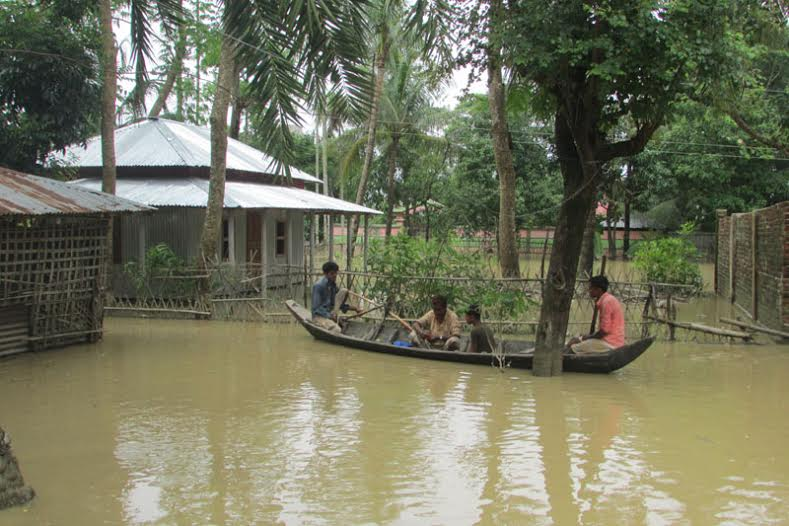 Taking a boat to get to the flooded daighor in Chakaria, Bangladesh. Photo: UBINIG