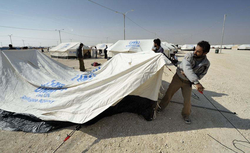 Workers erect new tents in the Zaatari Refugee Camp, located near Mafraq, Jordan. Photo:ACT/Paul Jeffrey