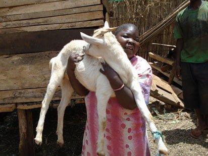 Awatu holding her goat Sikitu. Photo: Dismas Menchi