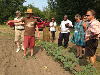 Farmer Dave speaks to the participants in Sharing Bread (Two) at the Sorrento Farm. Photo: Suzanne Rumsey