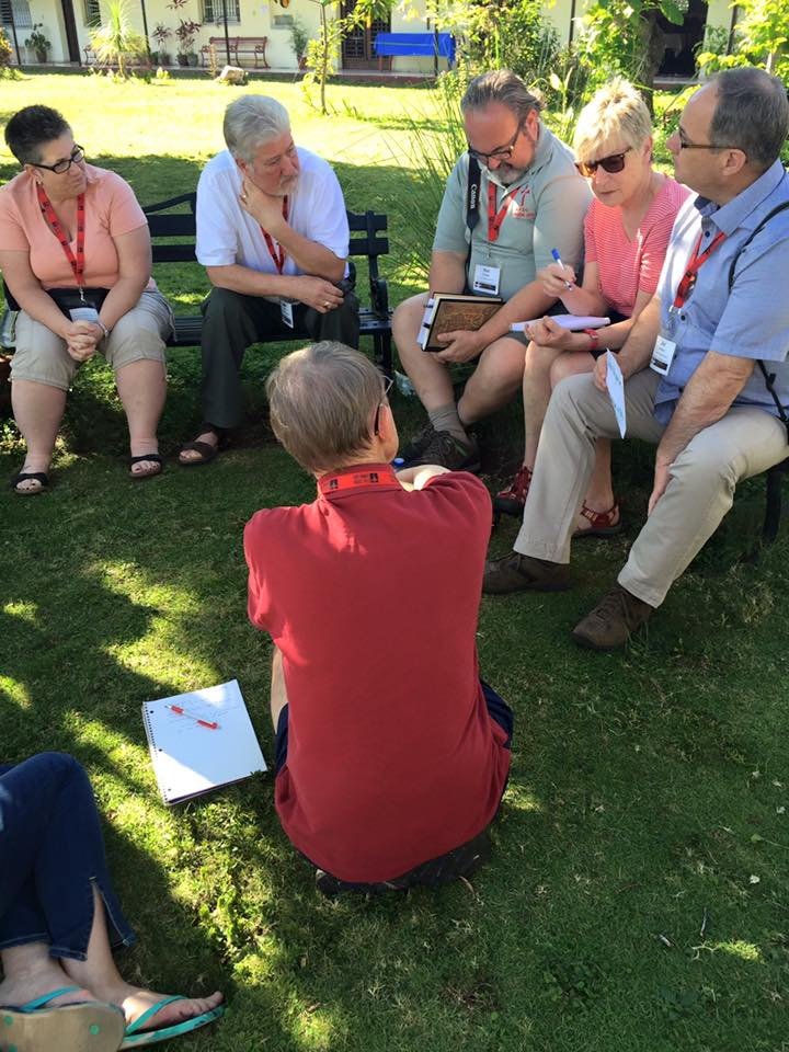 Justice Camp participants debriefing after their immersion groups have regathered together. Photo: Diocese of Niagara