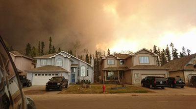 Wildfires loom in Fort McMurray earlier this week. Photo: Jodi Schmidt