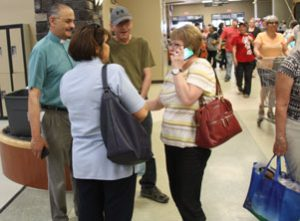 Clive and Deborah Scheepers (left) talking with evacuees at the Bold Centre in Lac La Biche, AB. Photo: Diocese of Edmonton