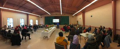 "Refugees gathering at St. John's Cathedral in Saskatoon at ""Hello, Neighbour!"" Photo: Hsin-Chen (Owen) Lu Community Development Worker"