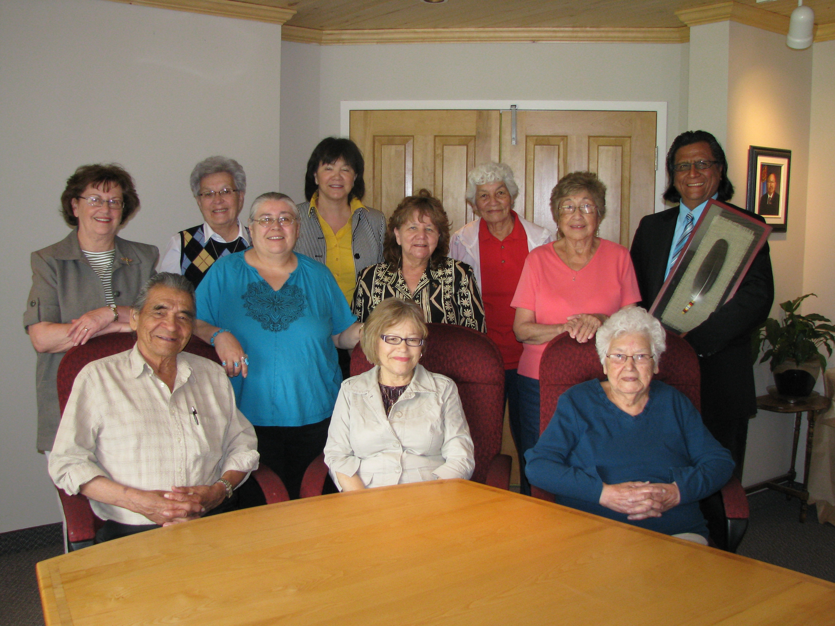 Jose Zarate (far right, standing) received an eagle feather from the Confederation of Mainland Mi'kmaq.