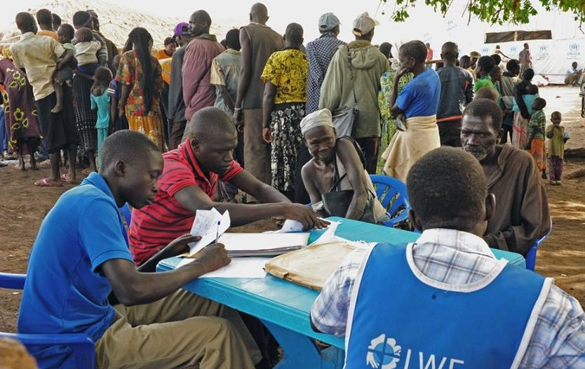 Aid workers perform intake of South Sudanese refugees at Palorinya refugee camp in Northern Uganda, Feb. 15, 2017, photo courtesy of LWF/ C. Kästner