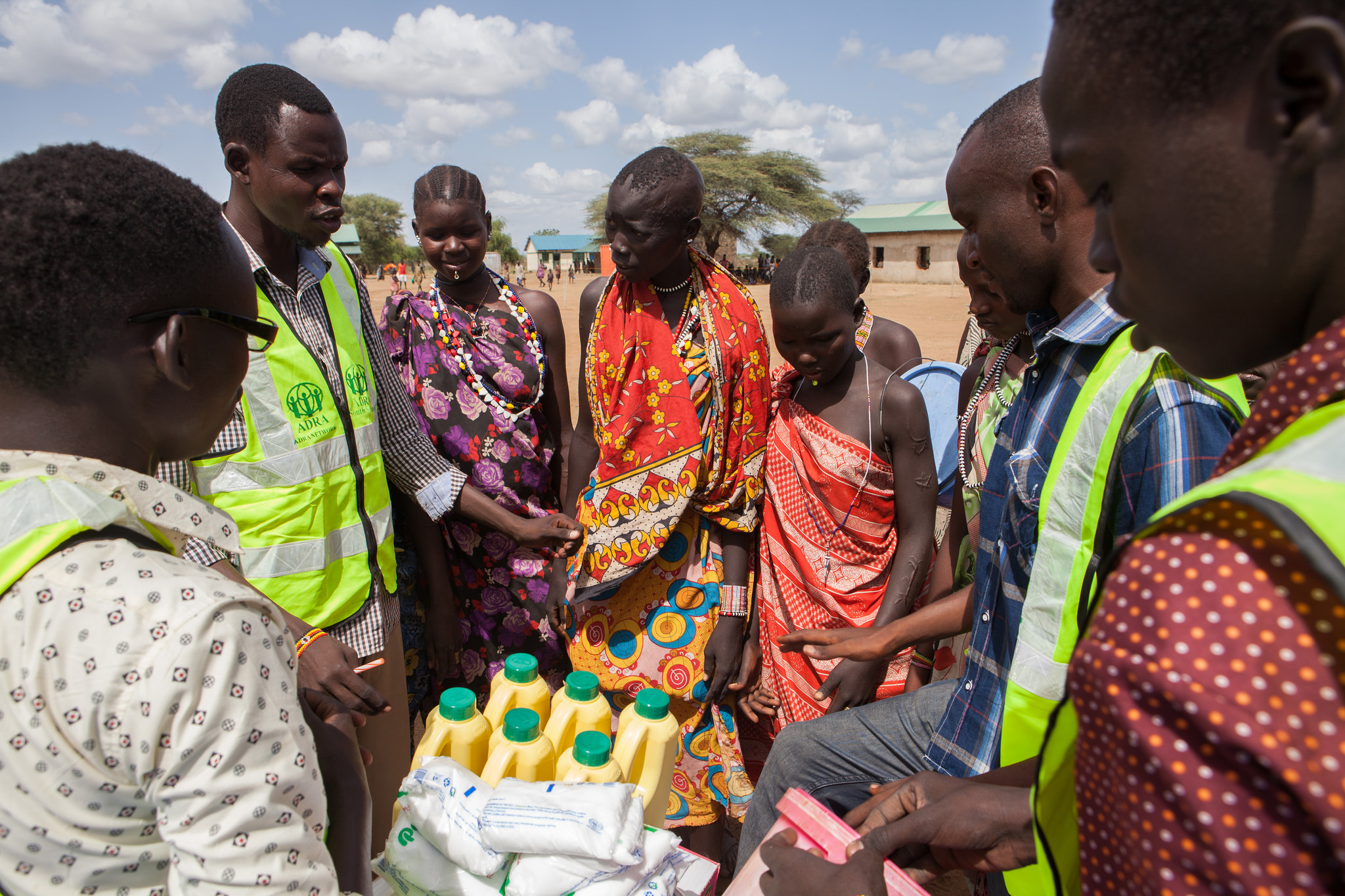 South Sudanese gather around at a food distribution project organized by ADRA South Sudan, funded in part by PWRDF.
