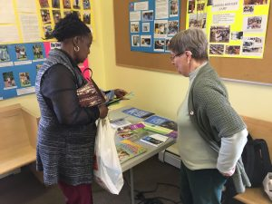 PWRDF Diocesan Representative Betty Davidson talk to a parishioner at St. Paul's, Dawson City about PWRDF.