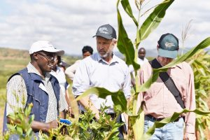 From left to right: Conservation agriculture farmer John Mbithi, Will Postma, and Foodgrains Bank board member Steve McInnis visit a Foodgrains Bank project in Kenya. (Photo: Courtney Klassen)