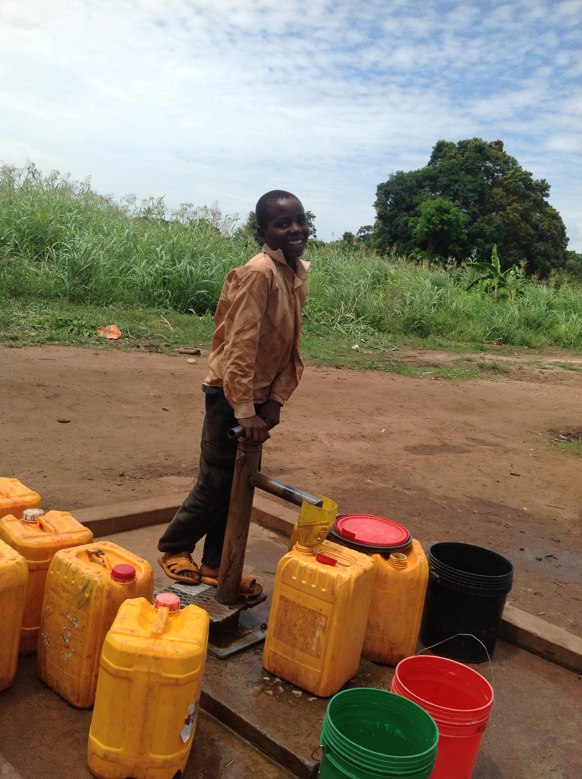 A boy pumps water in Ruponda, Tanzania. A new borehole in the village provides water for 3000 people. Photo: Zaida Bastos