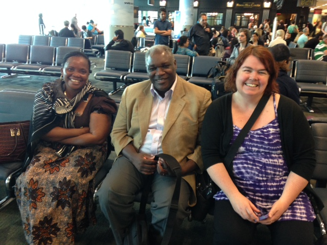 Joyce Mtauka, Geoffrey Monjesa and Sheilagh McGlynn await their flight on their way to Sorrento, BC. Photo: Suzanne Rumsey