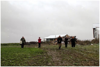 Diocesan representatives braving the elements on a farm tour. Photo: Carolyn Vanderlip