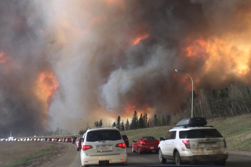 By DarrenRD - File:Landscape view of wildfire near Highway 63 in south Fort McMurray.jpg, CC BY-SA 4.0, https://commons.wikimedia.org/w/index.php?curid=48561288