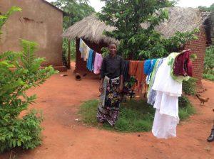 Selina shows off Novatus' clean laundry. Photo: Zaida Bastos