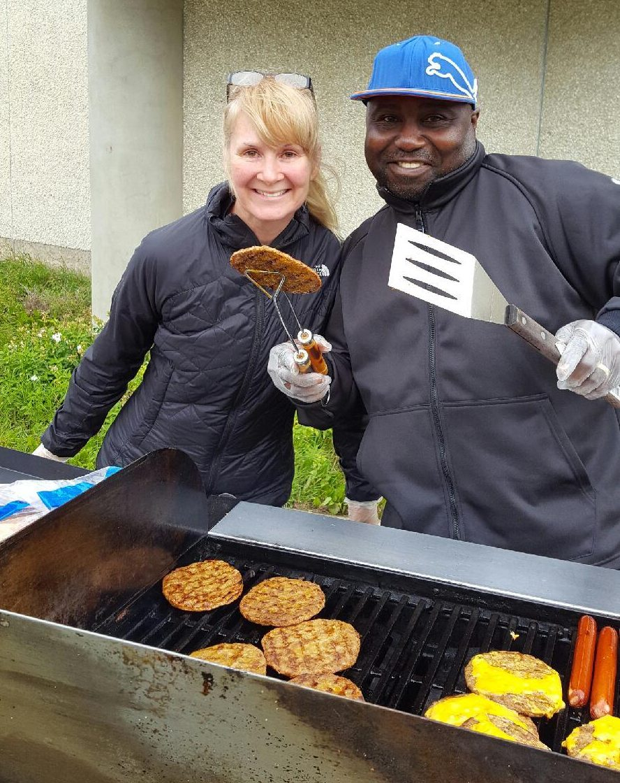 Susan Newton and Toks Adebayo serving lunch at the BBQ after the Thanksgiving service in Fort McMurray. Photo: Heather Roberts