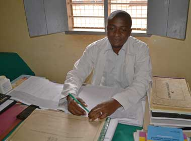 Dr. Selemane Kazibwe is proud to be part of the health team at the Nanganga clinic.  Photo: Bart Dickinson