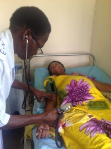 A pregnant woman is examined at a health clinic in Tanzania. Photo: Zaida Bastos