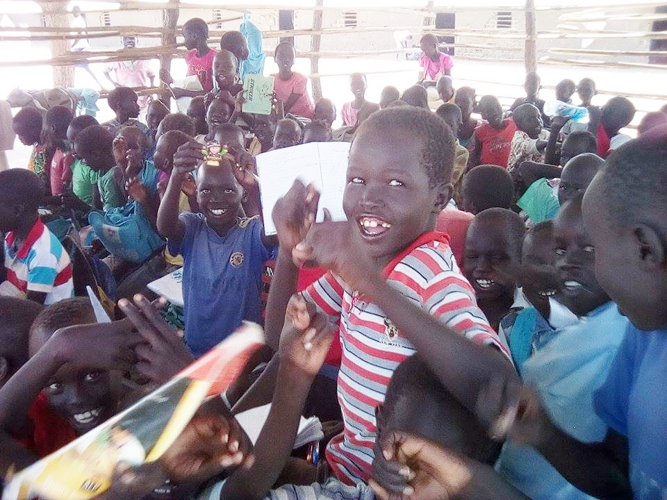 Orphaned children come to the Women's Community Resource Centre in Bor for literacy classes.