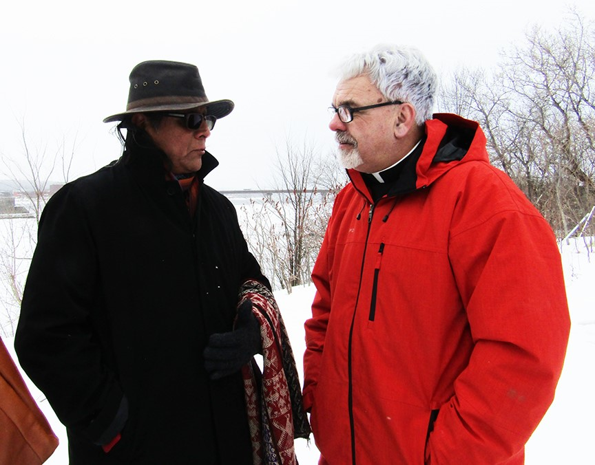 Dr. José Zárate and Bishop David Edwards chat during the World Water Day ceremony at St. Mary's First Nation in Fredericton.