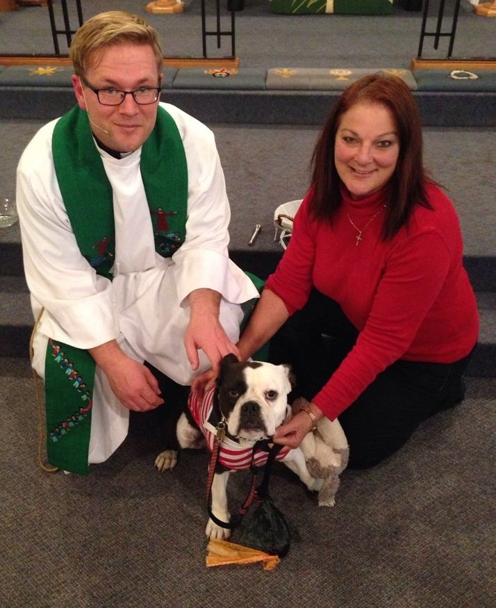 "Reverend Dane Neufeld and Betty-Anne Eldredge with her dog ""baby Gussie"" at the pet blessing at All Saints."