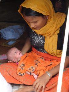 Toslima and her newborn baby. World Renew photo.