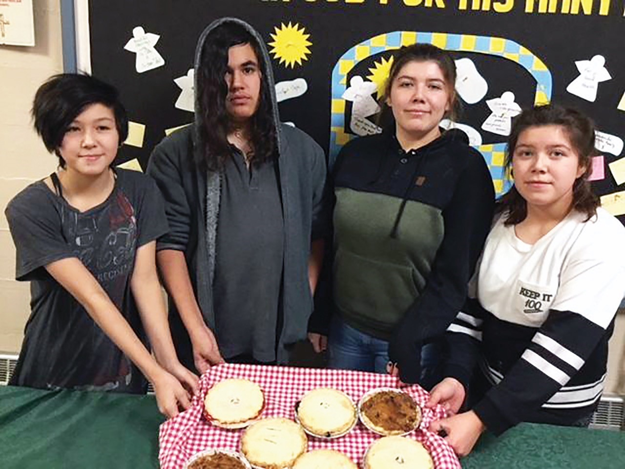 Youth Group members from Holy Trinity Church in Cochrane, Ont., sell their monster cookies.