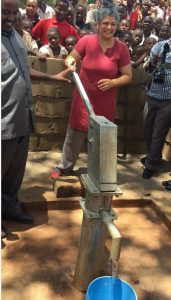 Harkiran Rajasansi, Deputy Director of KSIS Social Empowerment for Global Affairs Canada, helped open a borewell in Tanzania in 2018.