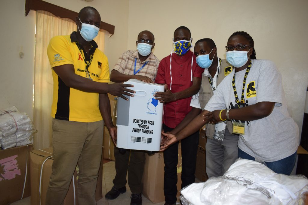 Staff of the Naitonal Council of Churches Kenya (NCCK) at the Kakuma Refugee Camp receive PPE supplies and medical devices, made possible by PWRDF donors.